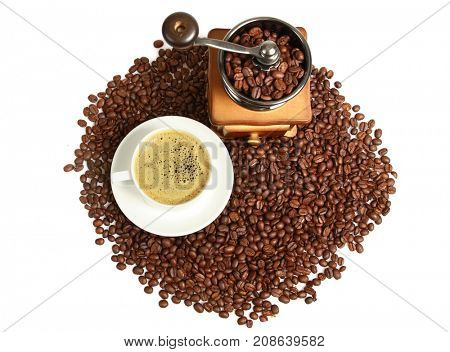 Vintage manual coffee grinder with coffee beans, hot coffee