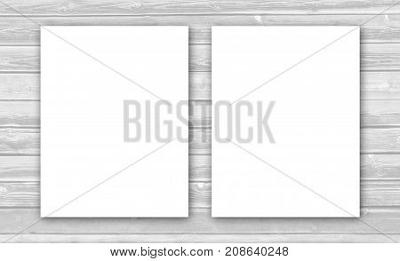 Two white sheets on a wooden wall with empty space for text and ads.