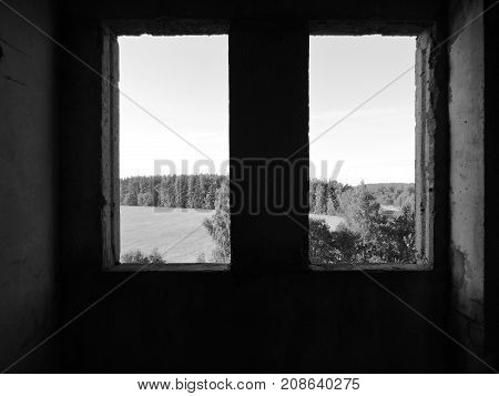 Two Windows in a dark abandoned building