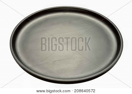 empty circle wooden black tray isolated on white. 45% angle view.
