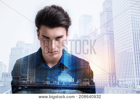 Leave me alone. Close up of furious teenager expressing negativity and looking at you while standing against urban surrounding