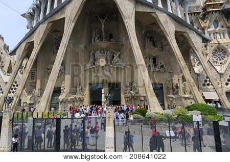 Barcelona Catalonia Spain - JUNE 9 2017 : Long lines of tourists waiting to enter The Basilica i Temple Expiatori de la Sagrada Família. This´s a large unfinished Roman Catholic church designed by architect Antoni Gaudí