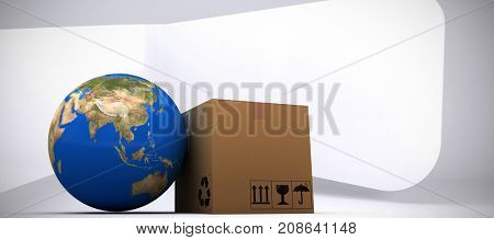3D image of planet Earth and box against abstract room