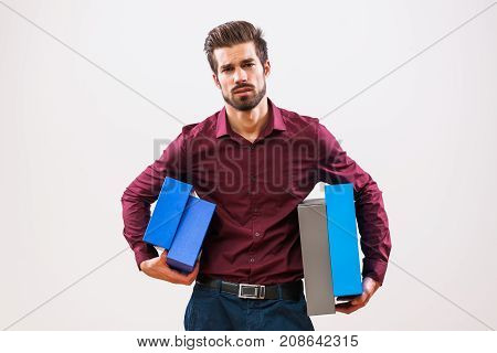 Portrait of young businessman who is unmotivated and overworked. poster