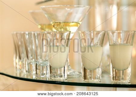 Catering services. Celebration. glasses with alcohol placed on the glass.