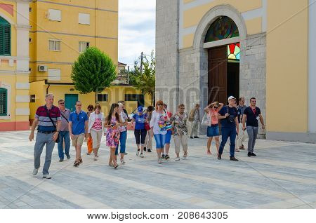 SHKODER ALBANIA - SEPTEMBER 6 2017: Group of unknown tourists are near St. Stephen's Cathedral Shkoder Albania