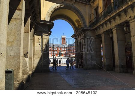 MADRID, SPAIN - MAY 24, 2017: This is one of the oldest arched passage to the Plaza Mayor.
