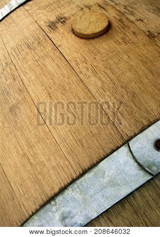 Close up of an oak barrel in a French winery