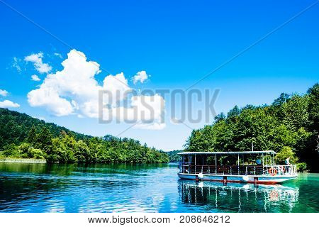 Sky and boat reflexion in the Plitvice Lakes in Croatia