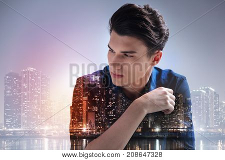 Constantly thinking. Close up of pleasant model expressing calmness while looking away against night city