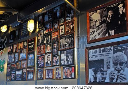 Sydney Australia - July 11 2014: Frames with photos of famous guests on the wall at Harry's Cafe de Wheels. Harry's Cafe de Wheels is an iconic pie cart in Woolloomooloo suburb New South Wales on Cowper Wharf Road.