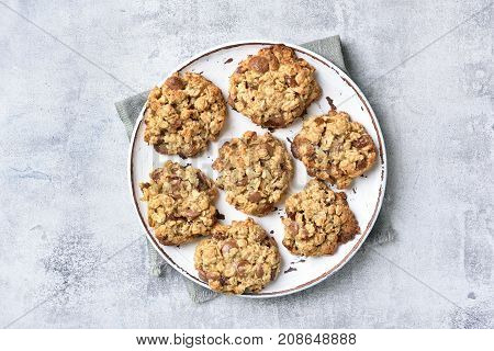 Oats cookies on plate over gray stone background top view