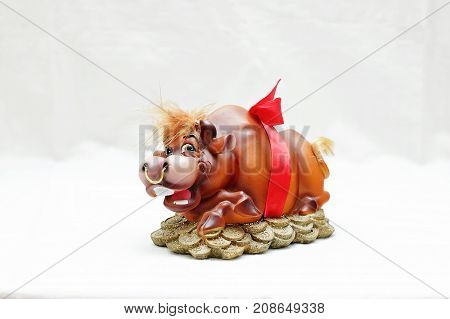 Souvenir piggy bank for coins in the form of a wild boar on a feng shui isolated on white background.