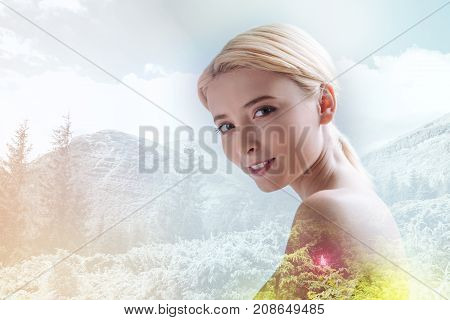 Beautiful nature. Close up of optimistic young model being photographed against outstanding picturesque