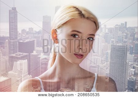 In youth blossom. Close up of charming girl having magnificent look while standing in urban surrounding