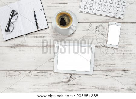 Office desk with tablet pc notebook cup of coffee. Business background with space for your image. Flat lay