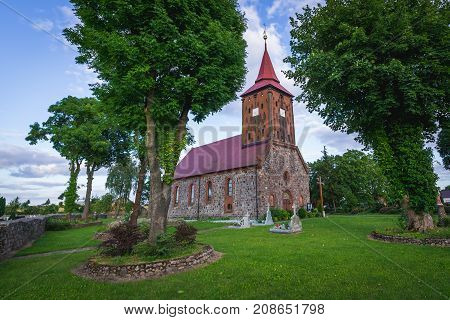 Zelechowo Poland - July 13 2017: Red bricks and stones church in small village Zelechowo West Pomerania region of Poland