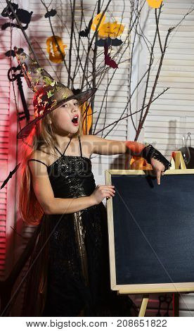 Girl With Explaining Face On Spooky Carnival Room Background