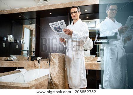 Businessman In Bathrobe Reading Newspaper