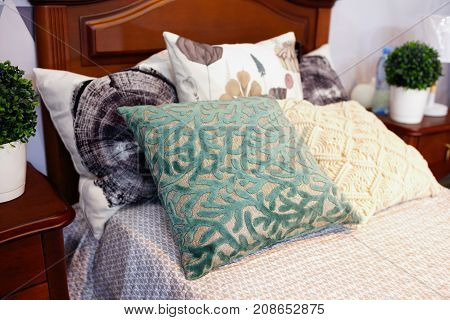 luxury modern style bedroom Interior of a hotel bedroom cushions close-up