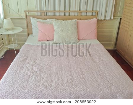 Pink and white pillow pink blanket in wood bedroom sweet interior