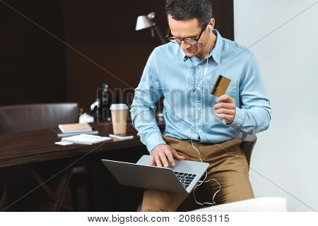 Businessman Using Credit Card And Laptop