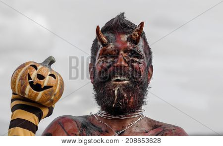 Halloween Satan Smiling With Beard, Red Blood, Wounds On Face