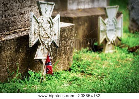 A miniature confederate flag on a Civil War veteran's grave in Virginia.