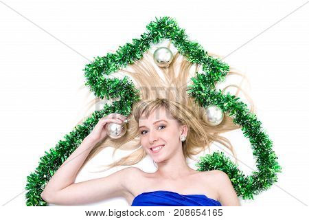 beautiful young smiling woman with Christmas decorations against isolated white background