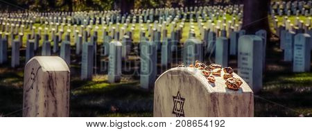 Some Jews believe putting stones on a grave keeps the soul in this world some believe the stones keep demons from getting into the graves.