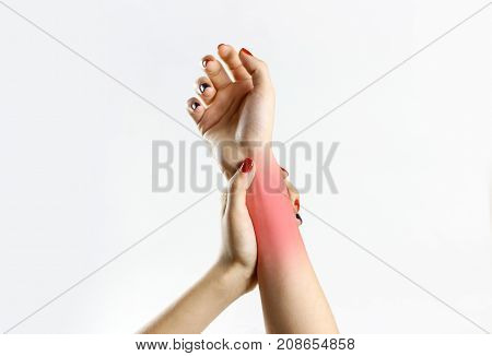 The Girl Has A Pain In His Hand. Holding His Hands Behind His Hand. Closeup