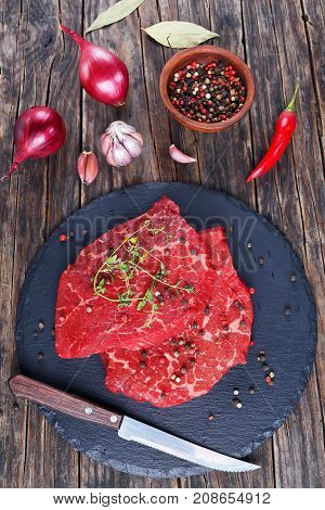 Two Marbled Beef Steaks On Slate Tray