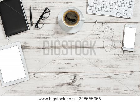 Office desk with tablet pc mobile cup of coffee. Business background with space for your text image picture. Flat lay
