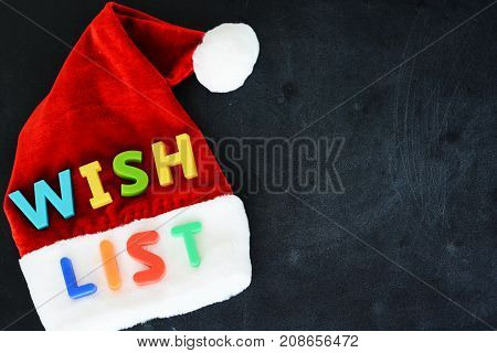 Santa Claus wish list concept with colorful text on Santa's red hat