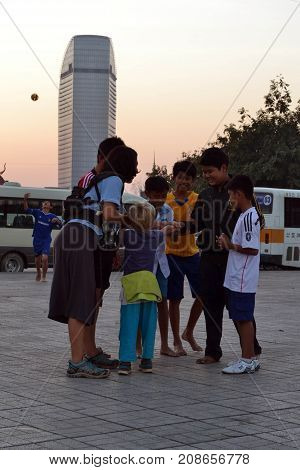 Locals And Tourist Playing Together At One Pedestrian In Phnom Penh, Cambodia
