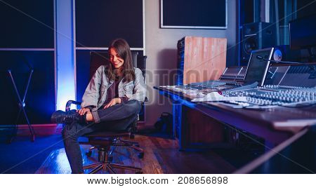 Smiling Young Woman Music Composer In Recording Studio