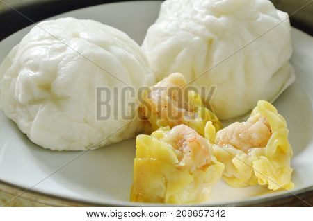 Chinese steamed bun stuffed minced pork and Dim sum on pot