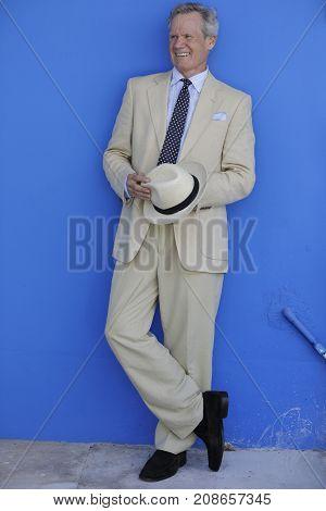 Mature Businessman On A Blue Wall