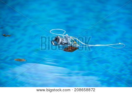 Underwater Photo Camera Housing Floating On Water