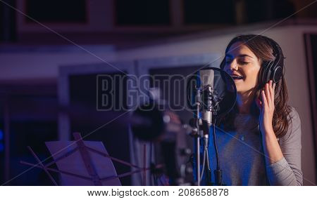 Playback Singer Recording Album In The Studio