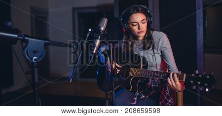 Female Singer Performing A Song In Studio