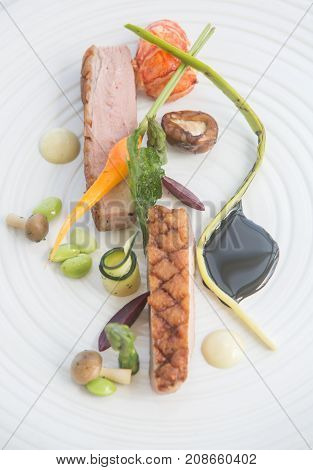 Roasted duck breast with vegetables. Gourmet kitchen