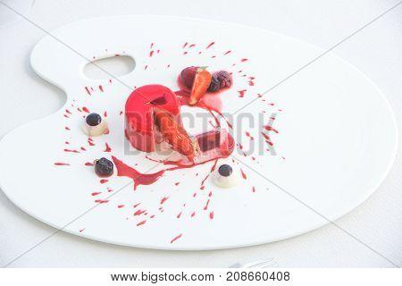 Halloween dessert. Strawberry panna cotta sprinkled with red sauce