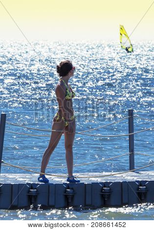 Back Side Of Pretty Girl Looking At The Sea, Travel And Active Lifestyle Concept