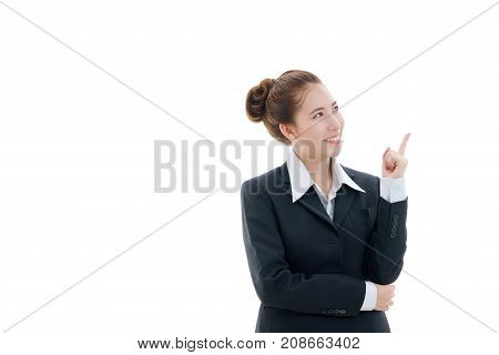 Smiling young Asian businesswoman in black suit and white t-shirt pointing finger isolated on white background