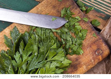 chopped parsley on a chopping board, top view