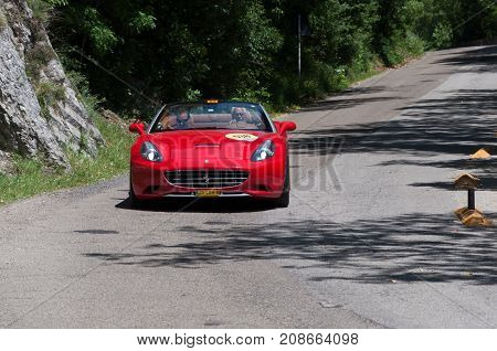 GOLA DEL FURLO, ITALY - FERRARI CALIFORNIA T 2015 on an old racing car in rally Mille Miglia 2017 the famous italian historical race (1927-1957) on May 19 2017