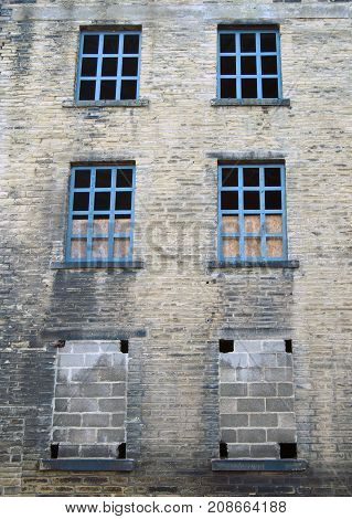 abandoned disused old derelict factory or mill building with broken windows in halifax west yorkshire england