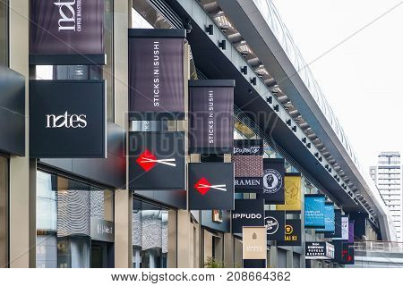 Signs Of Restaurants And Shops Displayed At Crossrail Place In Canary Wharf