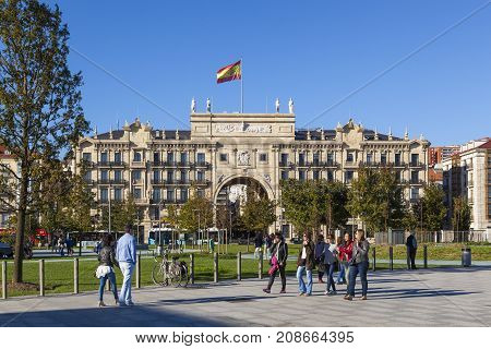 SANTANDER SPAIN - OCTOBER 7 2017: Tourists stroll on the Paseo Pereda boulevard in front of the heaquarters building of Banco de Santander.